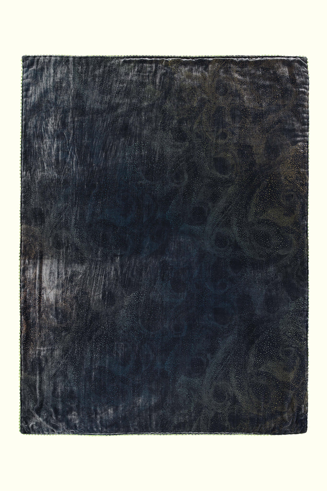 A luxury British silk velvet bed throw by GVE in navy and gold Aurora print design.