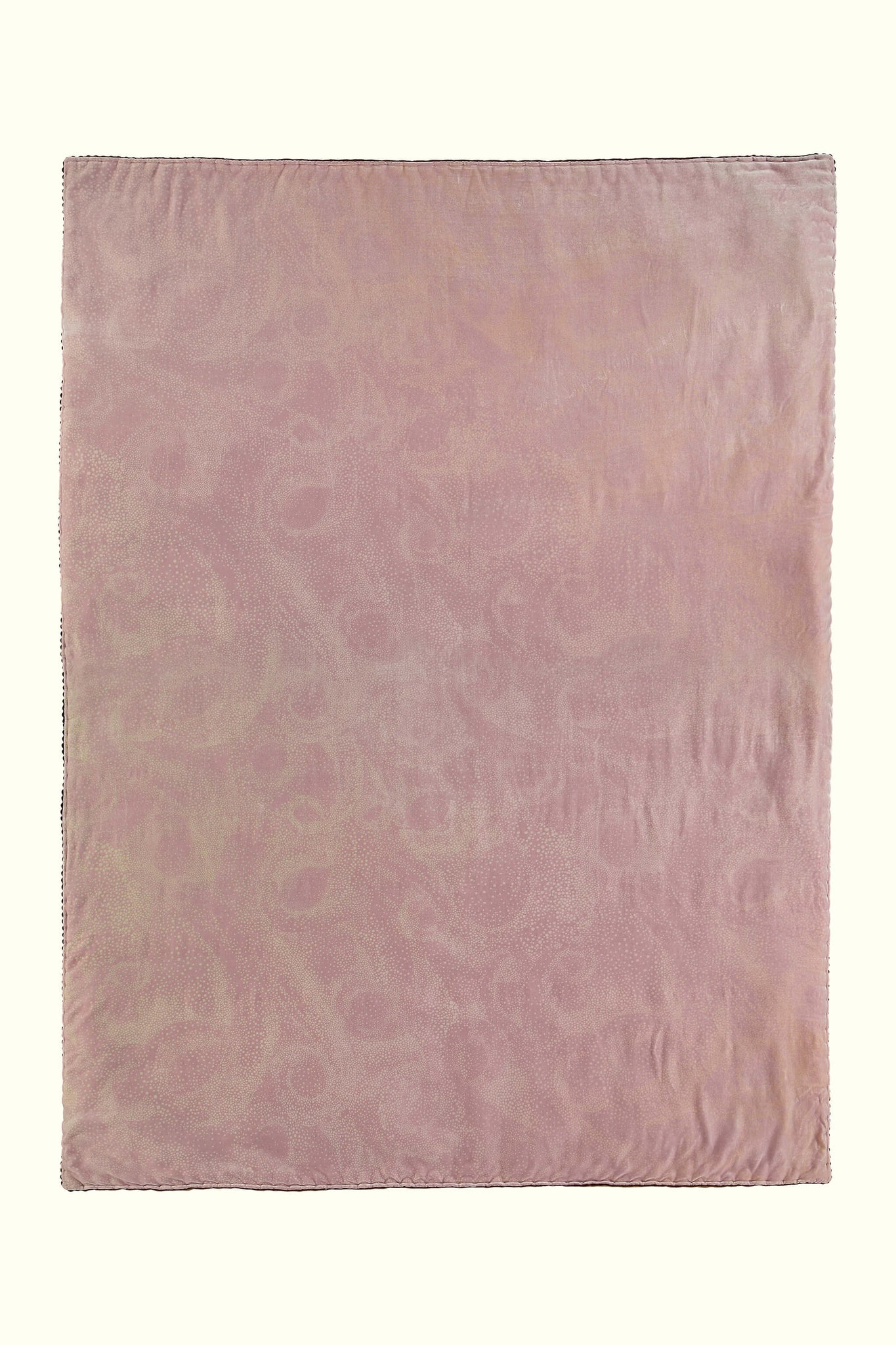 A luxury British silk velvet bed throw by GVE in dusty pink Aurora print design.