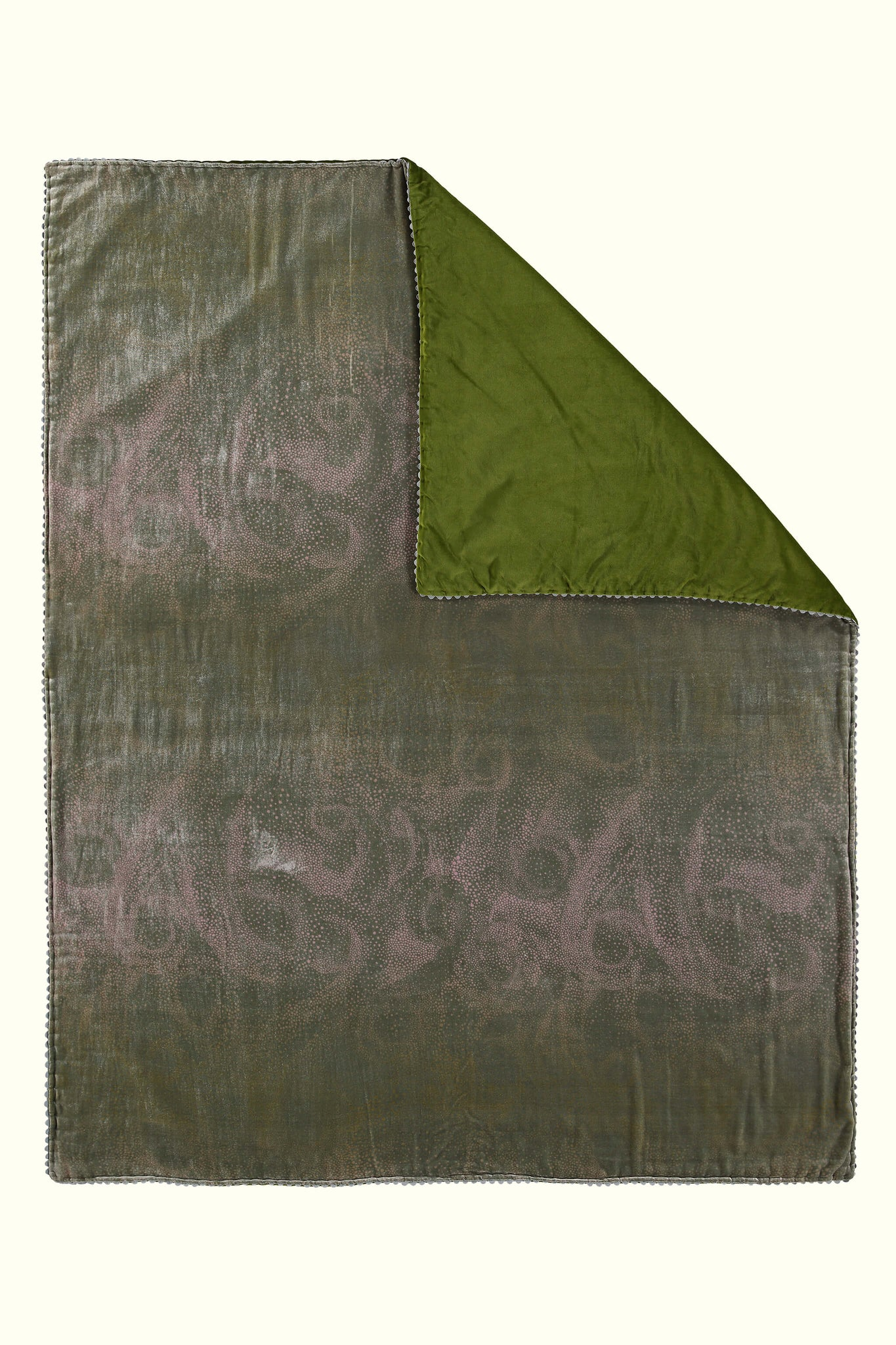 A luxury British silk velvet bed throw by GVE in olive and pink Aurora print design.