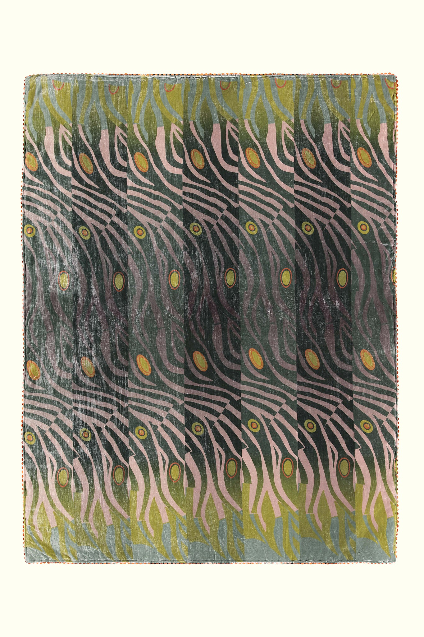A luxury British silk velvet bed throw by GVE in olive and old rose Dune print design.