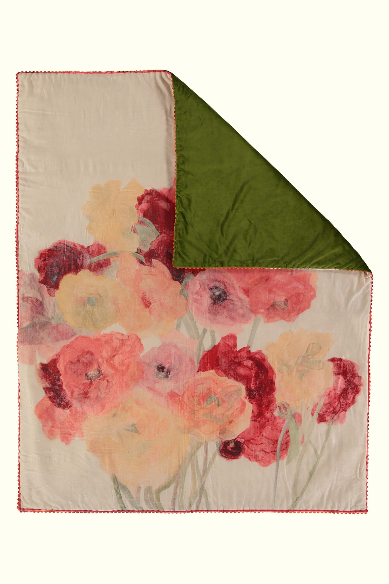 A luxury British silk velvet bed throw by GVE in cream and scarlet Ranunculus print design.