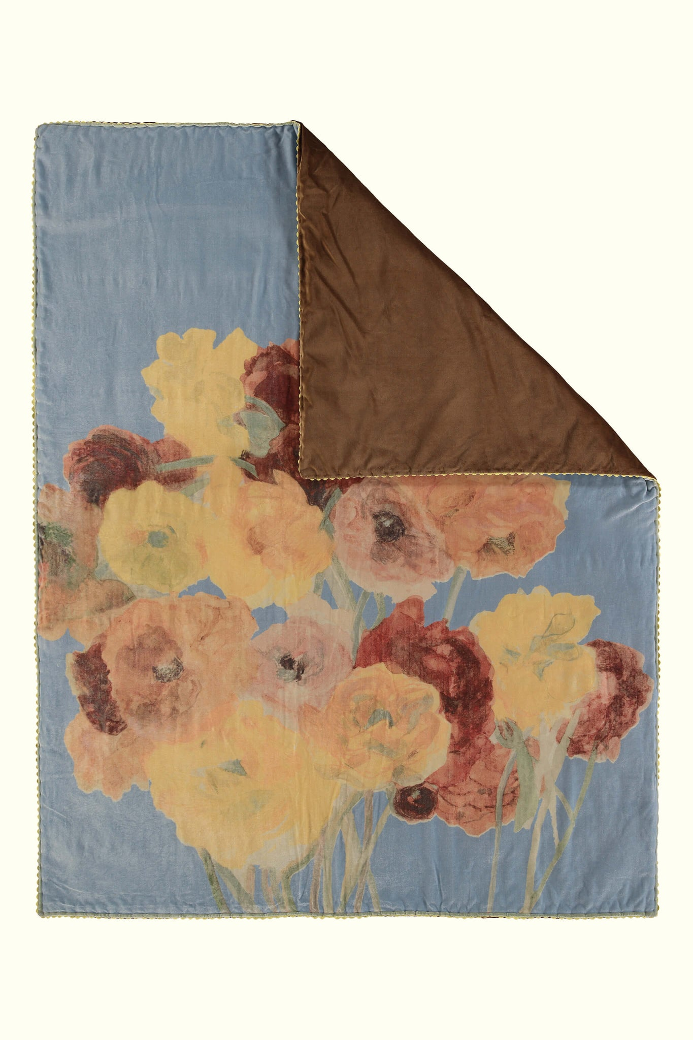 A luxury British silk velvet bed throw by GVE in dove grey ochre Ranunculus print design.