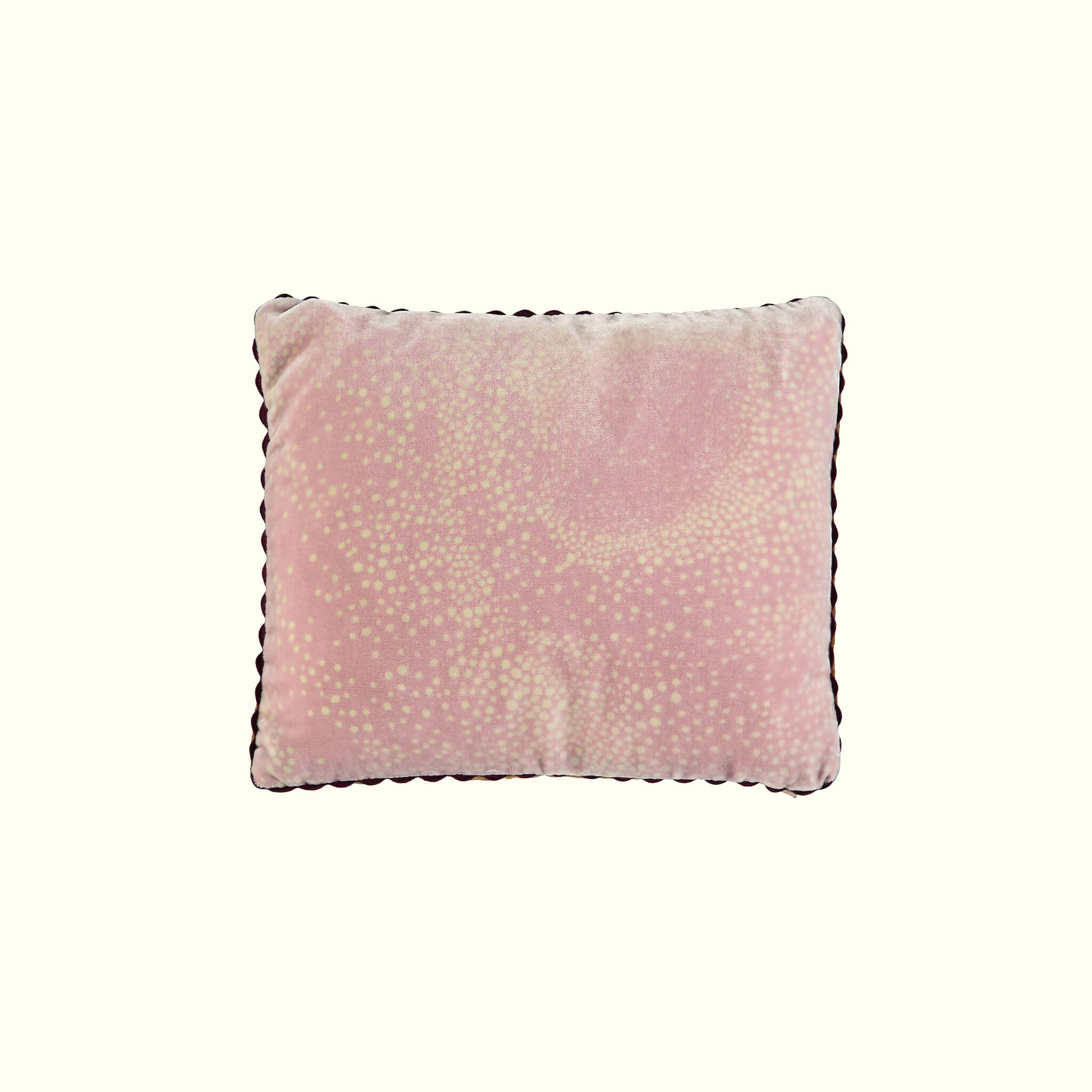 A luxury British silk velvet travel pillow by GVE in dusty pink Aurora print design.