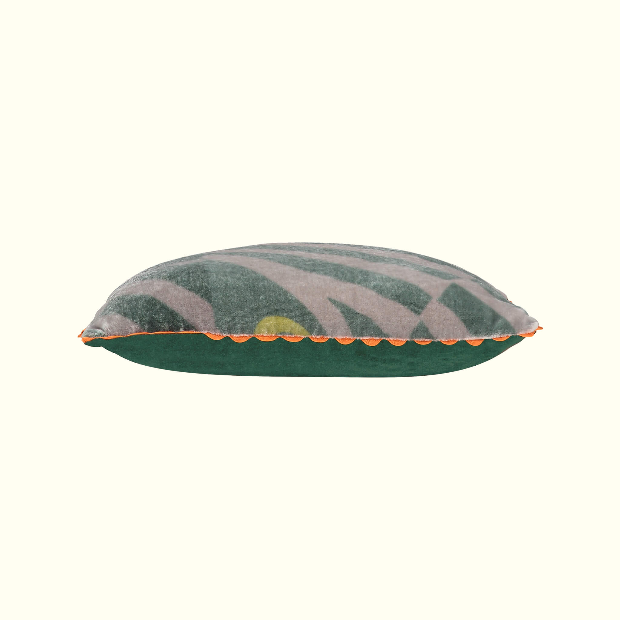 A luxury British silk velvet travel pillow by GVE in olive Dune print design.
