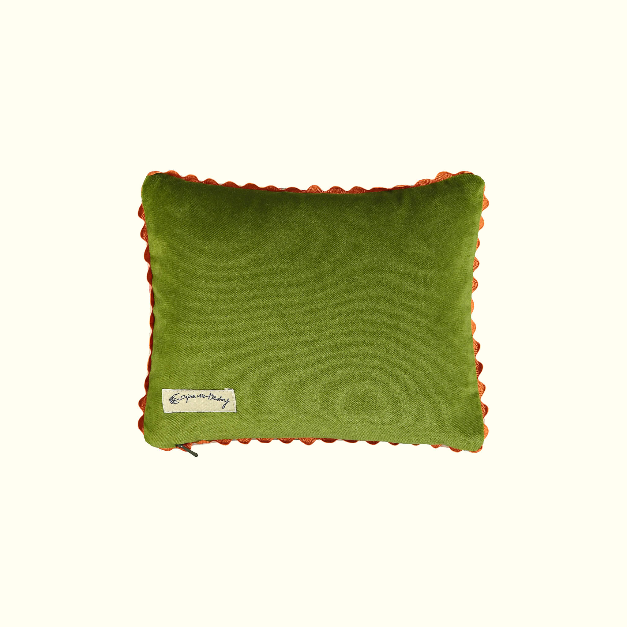 A luxury British cotton velvet travel pillow by GVE in cream and scarlet Ranunculus print design.