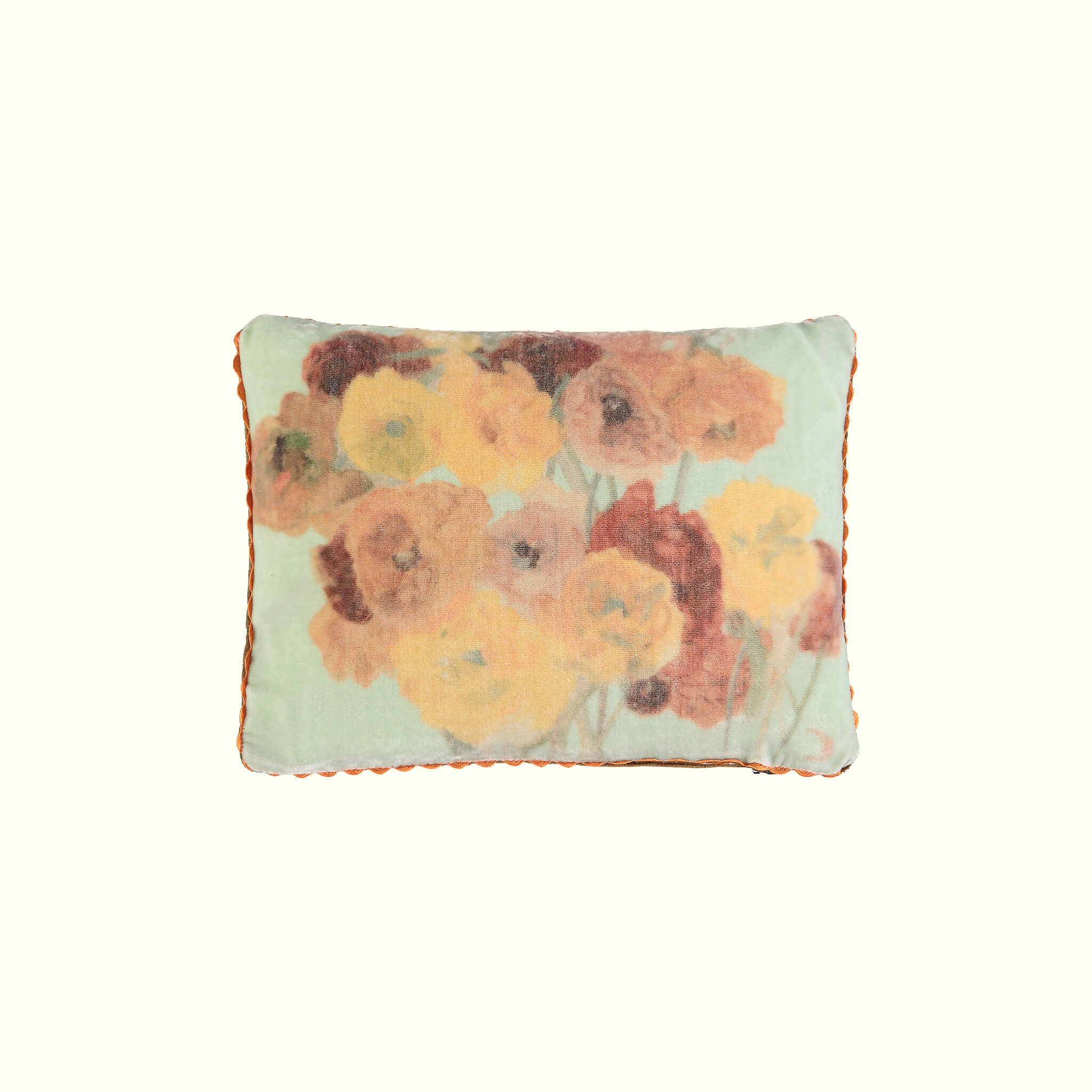 A luxury British silk velvet travel pillow by GVE in mint ochre Ranunculus print design.