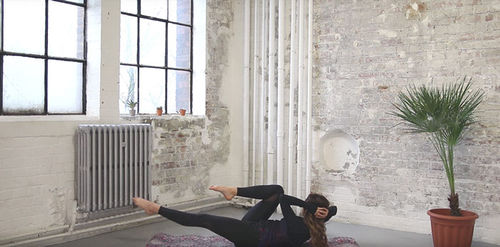 Lottie Murphy - Criss Cross Pilates position