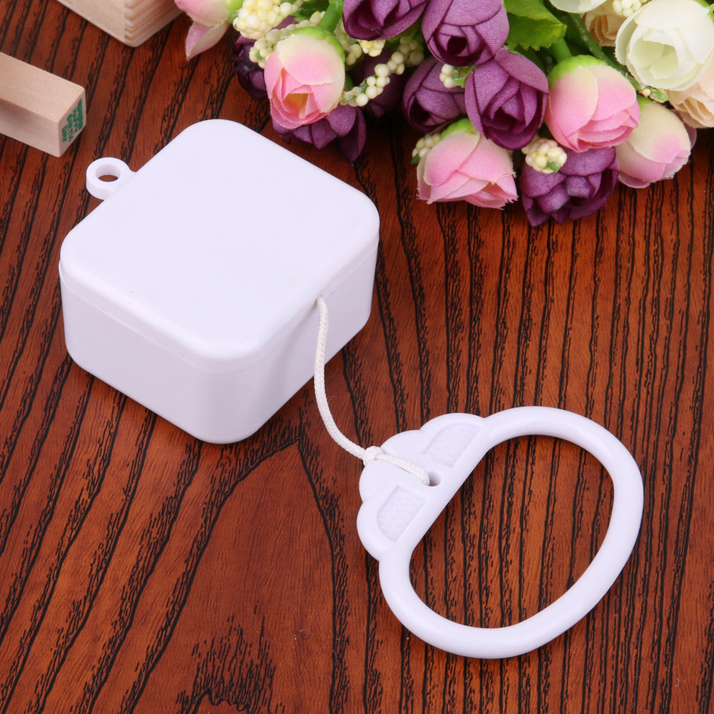 lovebabymammy.com 1 pcs Plastic Pull String Clockwork Cord Music Box Pull Ring Music Box White ABS  Baby Kids Bed Bell Rattle Toy  Birthday Gift