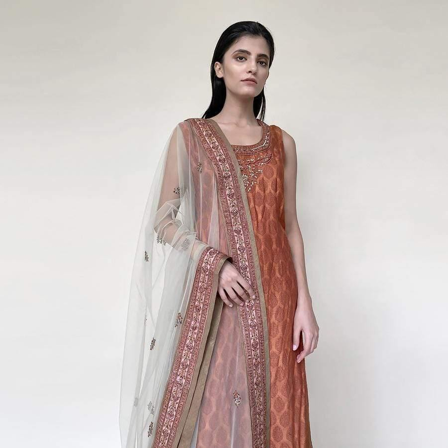 Tanchoi Kurta with fine self texture sleeveless kurta with embellished dupatta and tissue chandheri sharara. There is fine Resham, sequin and katdan embroidery. the look has elegant vibes. it works perfectly for an evening simple get together with family.
