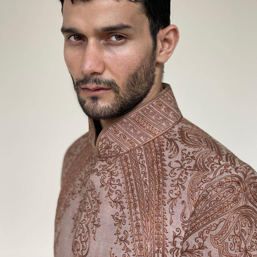 Monochrome silk thread embroidered bandgala in chain stitch. The intricate paisley motifs and designs of traditional jamawar are embellished on handloom silk truly give a rich and distinctive look to bandgala.  Abhishek Sharma, abhishekstudio