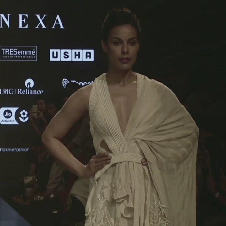 Load and play video in Gallery viewer, Silk Organza fine palm embellished lehenga with a sculpted 3D textured blouse with dupatta is an elegant yet bold outfit. It is a fine representation of our craftsmanship and our take on the amalgamation of traditional and modern trends. The lehenga has a very elegant dreamy feel that can perfectly complement the flawless you.  Abhishek Sharma, abhishekstudio