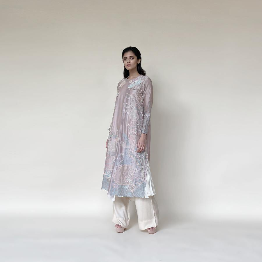Embellished Kurt with front plate, wide pants and dupatta. The kurta has fine resham and pearl 3D embroidery that adds the elegance to the look. It's a look that works for day and night both.