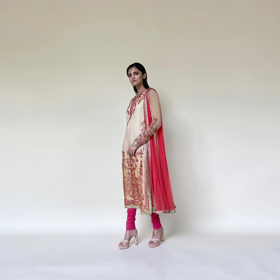 Organza Kurta with fine Resham and sequin embroidery in floral motifs. the kurta is a perfect pick for a simple pooja or function at home. the style has a simple elegant feel and can be styled with elegant gold or Polki earrings.