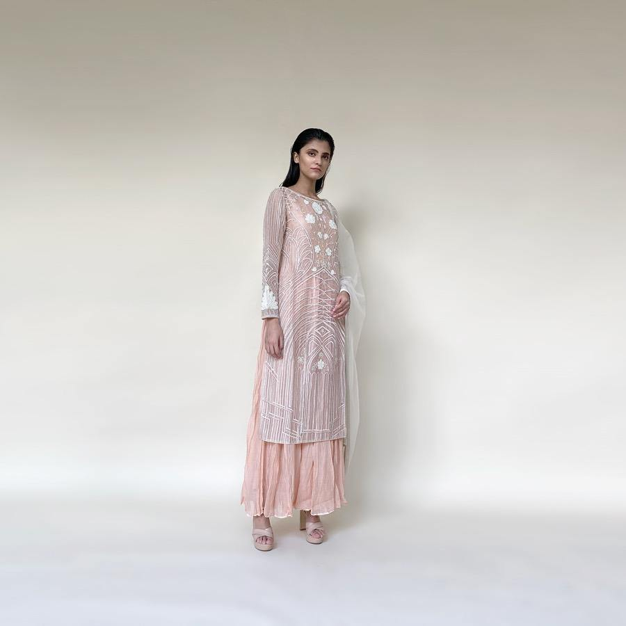 Organza silk kurta with fine Gresham and velvet applique embroidery embellished with pearl and katdana. There is separate crinkled voile inner that gives the style a layered look. Elegance and delicate details are the main focus of the look. Abhishek Sharma, abhishekstudio