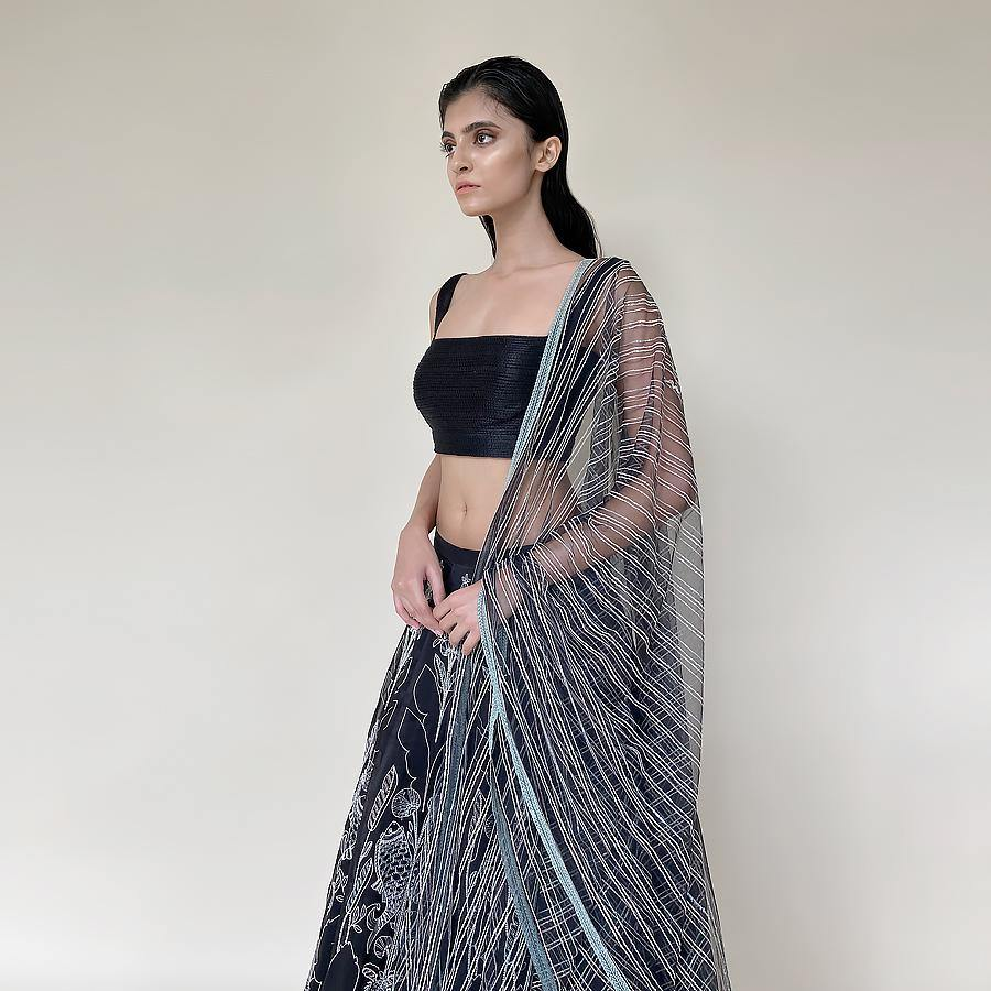 Organza silk lengha with a textured detailed blouse and net dupatta. The Lehenga has nice Gresham and sequin embroidery with a hint of fine pearls. The lehenga has a fine play of pastel colours that makes it unique. Abhishek Sharma, abhishekstudio