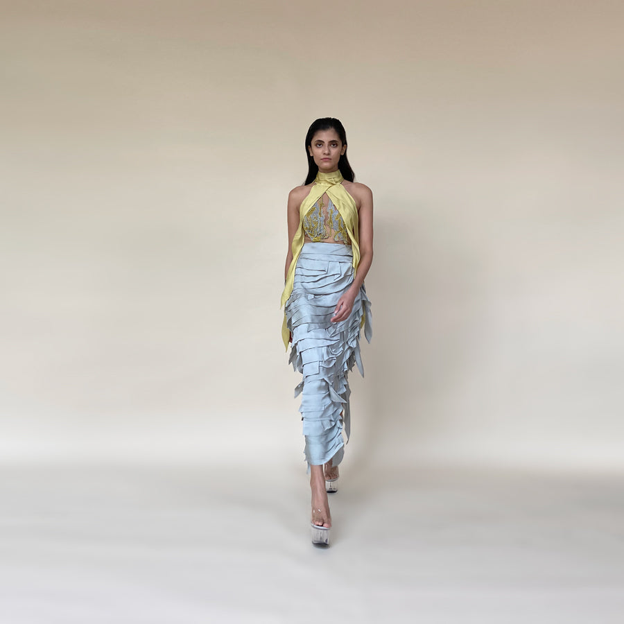 The look has turtle neck draped embroidery detailing along with satin drip texturing. The skirt has multiple layer of satin with asymmetrical patterns. The look is perfect for red carpet and event where you are the head turner. Lead the evening with this power packed strong look. Abhishek Sharma, abhishekstudio