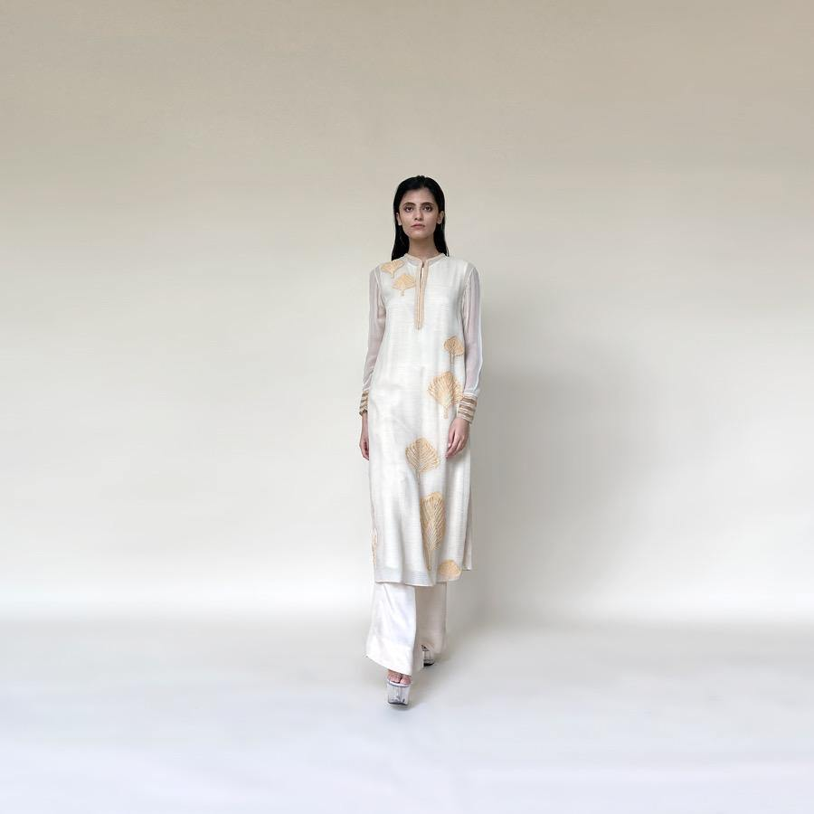 Textured chiffon straight cut classic kurta with fine Resham and pearl placement embroidery. The kurta has a separate lining and wide pants. The look is classic and elegant and works perfectly well for the day.