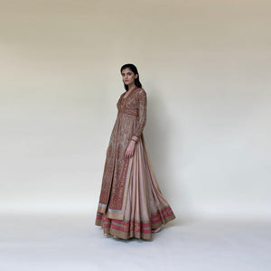 Organza embellished long jacket style with floor-length Anarkali. The jacket has fine Resham, katdana and sequin embroidery that has a vintage feel. The look is inspired by vintage royal India bringing back the luxury of old times. The has traditional and delicate vibes perfect for someone who loves to collect special peace. Abhishek Sharma, abhishekstudio