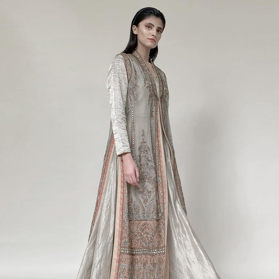 Silk organza embellished long jacket teamed up with floor-length Anarkali. There is fine Resham, sequin and katdana detailing along with brocade edging. the look has very regal and old-world feel will elegance and grace as underlining. The look is perfect for someone who loves the intricacy in design and has a feeling for the vintage. The look can work perfectly for day and night.  abhishekstudio, abhisheksharma