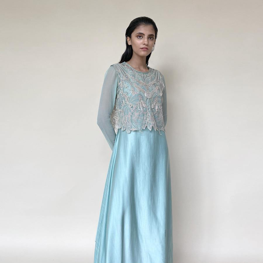 Shear organza crop top tailored with chiffon sleeves and satin draped dress. Top is embellished with intricate sequin/pearl embroidery and bugle beads in forest motifs.  abhisheksharma , abhishekstudio