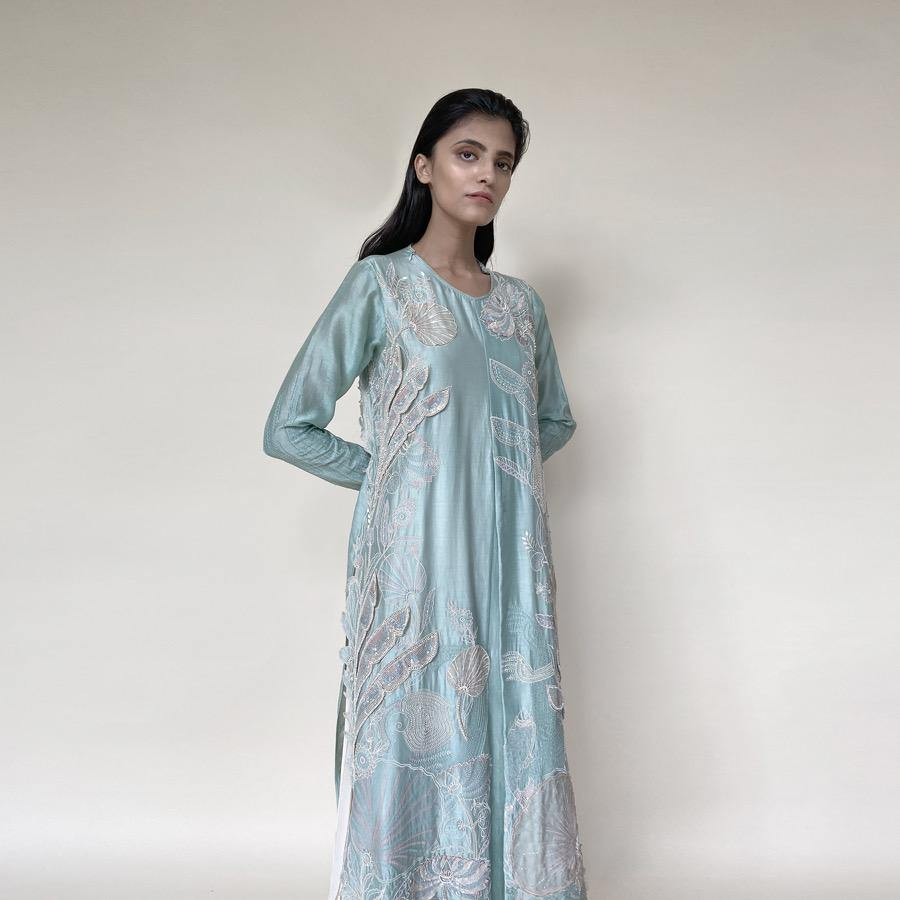 Embellished Kurt with front plate, wide pants and dupatta. The kurta has fine resham and pearl 3D embroidery that adds the elegance to the look. It's a look that works for day and night both. Abhishek Sharma, abhishekstudio.