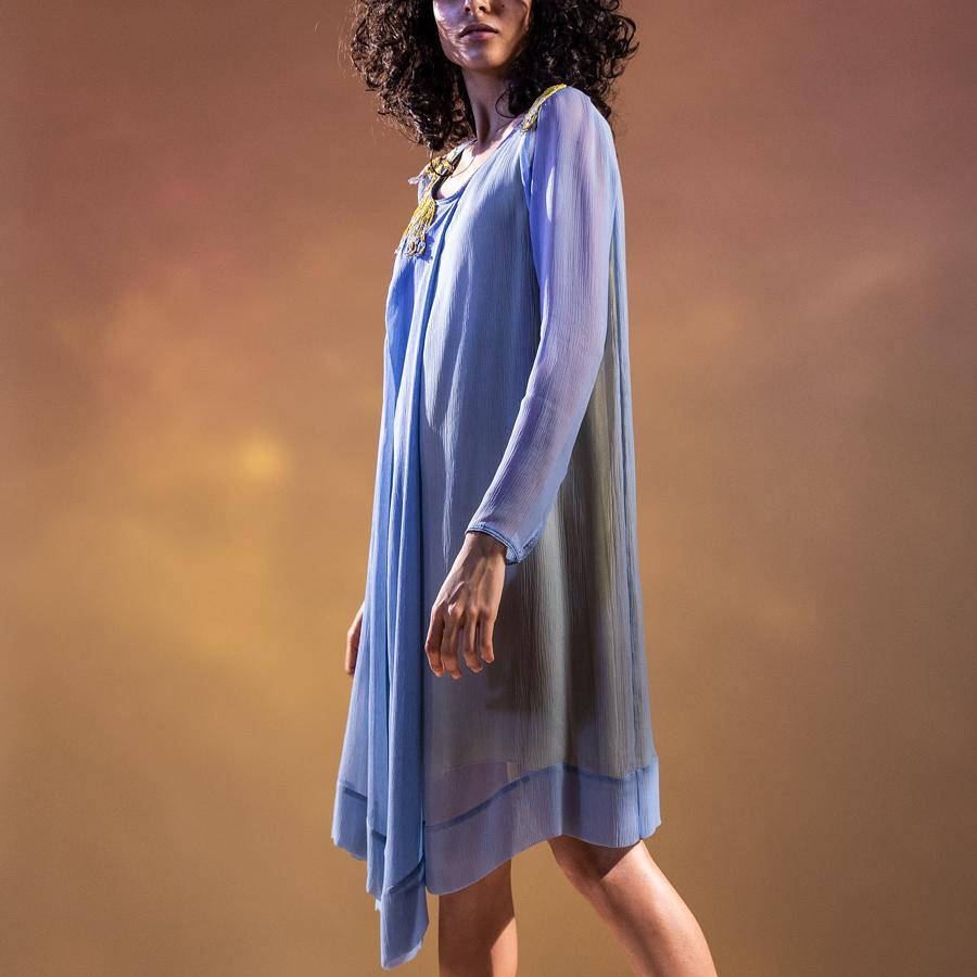 Chiffon draped asymmetrical tunic with front pleating. The tunic has a contrast lining to bring in the punch in the colour.   Styling: the tunic can be worn as a dress as shot on the model. It can also be teamed up with a pair of denim and fitted pants.  abhishekstudio, abhisheksharma