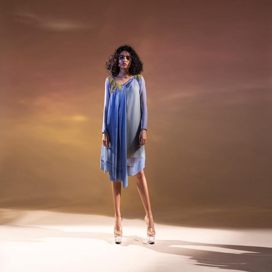 Chiffon draped asymmetrical tunic with front pleating. The tunic has a contrast lining to bring in the punch in the colour.   Styling: the tunic can be worn as a dress as shot on the model. It can also be teamed up with a pair of denim and fitted pants.  abhishekstudio, abhisheksharma.