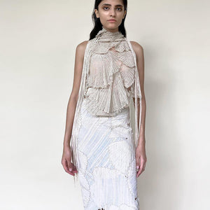 Huddled in-cut shoulder top with draped embroidery teamed up with high waisted patchwork skirt. The look is inspired by the whimsical nature of the forest and the play of varied textures of flora n fauna. The skirt is a patchwork of single detailed leafs that are put together to create this beautifully layered leaf feel in an asymmetrical way. Abhishek sharma, abhiahekstudio