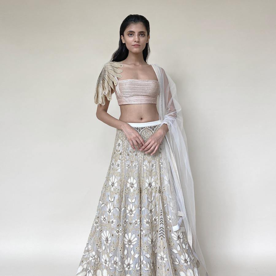 Load image into Gallery viewer, Organza lengha ornated with fine Resham, beads and velvet applique embroidery. The Lehenga has elegance and luxury as it's defining features. The Lehenga is designed keeping in mind the modern-day bride who is confident and know how to be in this global world. The look is perfect for a day wedding reception or even for rokka. The look can be styled with diamonds and pearl exotic jewellery.  Abhishek Sharma, abhishekstudio.