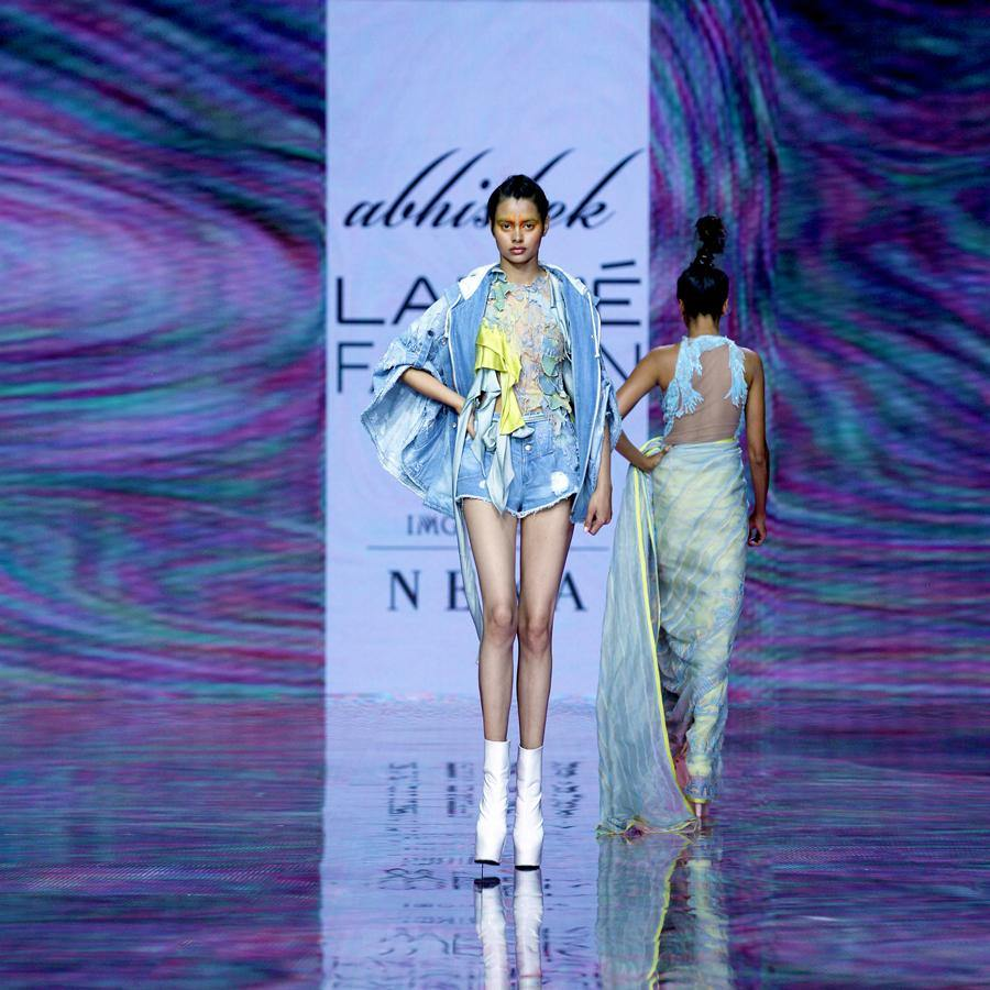 Multi textured short top embellished with 3D draped embroidery and satin drip detailing. The tope can be teamed with teared denim or even with wide pants. Abhishek Sharma, Abhishekstudio.