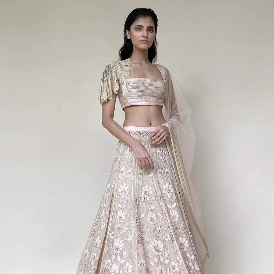 Organza lengha ornated with fine Resham, beads and velvet applique embroidery. The Lehenga has elegance and luxury as it's defining features. The Lehenga is designed keeping in mind the modern-day bride who is confident and know how to be in this global world. The look is perfect for a day wedding reception or even for rokka. The look can be styled with diamonds and pearl exotic jewellery.  Abhishek Sharma, abhishekstudio