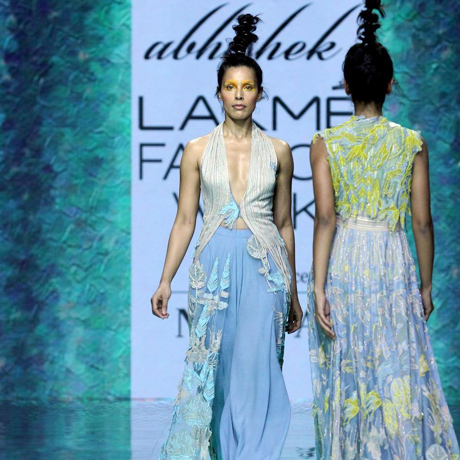 fresh-off-the-runway collection features unconventional draped halter long jacket. The jacket is inspired by the beautiful mountain seance view in the morning hues. The look has a very calming vibe yet with a interesting twist to it. a perfect look for a evening where you are the start. Abhishekstudio, Abhishek Sharma