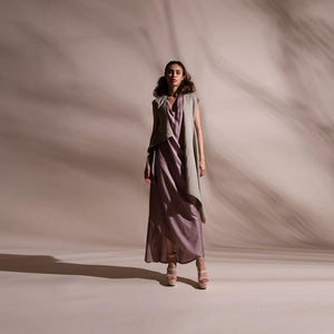Asymmetric sleeveless draped jacket teamed up with satin draped dress. Crafted in fluid fabrics, Abhishek Sharma's modern statement pieces pack in innovative drapery. abhishek sharma, abhishekstudio