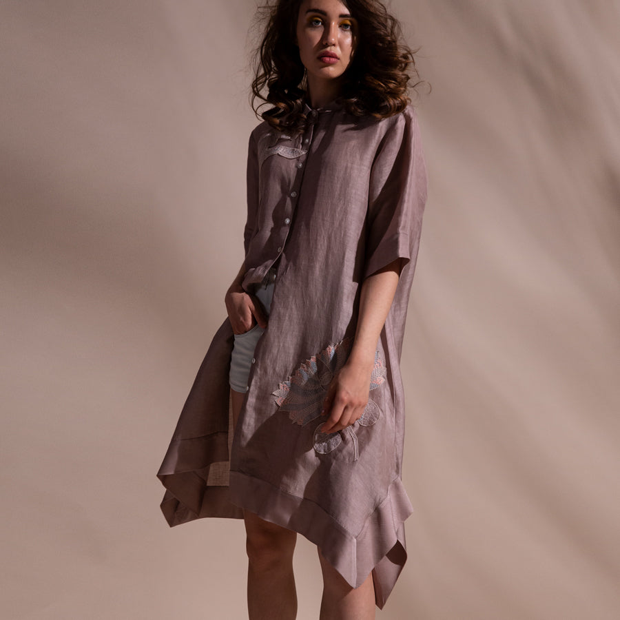 Knee length shirt dress thread 3D placement embroidery. Shirt has a 3/4th sleeve length with front button closure and asymmetric hem. abhishek sharma, abhishekstudio