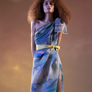 Abhishek Sharma's fresh-off-the-runway collection features unconventional drapes with printed textures. Impressionist printed fine pleated one-off shoulder tie-up dress with high side slit. The dress has a young vibe. Ideal for a poolside party. You can style the dress with satin tie-up belt as shot on model or you can wear a sleek belt to accentuate the waist. Abhishekstudio, Abhishek Sharma