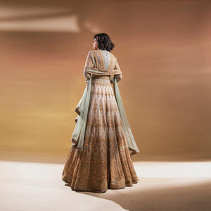 Silk organza embellished multi panelled flared jacket with fluted bodice and shaped duptta teamed up flared plain skirt. The look has a traditional regal feel and is perfect for Wedding functions.  Styling : The is perfect for some who has taste for intricate embroidery and appreciates a twist to traditional classic look. Style it vintage polki jewellery. Abhishekstudio, Abhishek Sharma