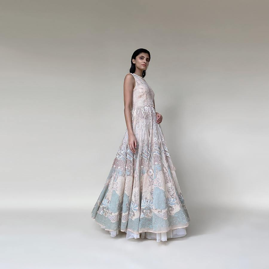 Silk organza floor length multi kali anarkali embellished with nice resham, pearl and katdana detailing. there is a fine play of various textures and motifs that gives the look a unique feel. The style has a cancan skirt and a net embellished dupatta. the look has elegance and style as the main vibe and looks stunning with diamonds and pearls. abhishek sharma, abhishekstudio