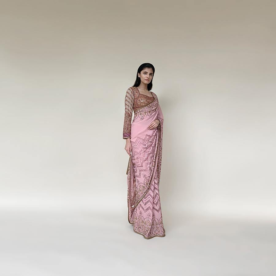 Load image into Gallery viewer, Chiffon saree with intricate net applique and fine Resham, sequin and katdana embroidery. The saree has a beautiful play of geometric and floral Mughal motifs that makes its artwork stand out. the blouse has a shaped yoke-style that connects the style to the royal vintage era with a geometric pattern on the sleeves. Abhishek Sharma, abhishekstudio