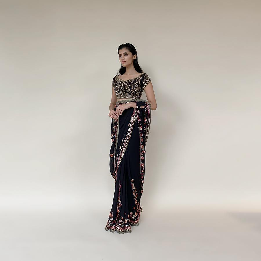 Georgette saree embellished with fine Resham and sequin creating a very traditional yet fun look. the blouse is embellished with fine Kasab and katdana detailing along with a hint of jewel tones. The saree colour is a deep navy blue very close to black making it a perfect look for the evening.  Abhishek Sharma, abhishekstudio.