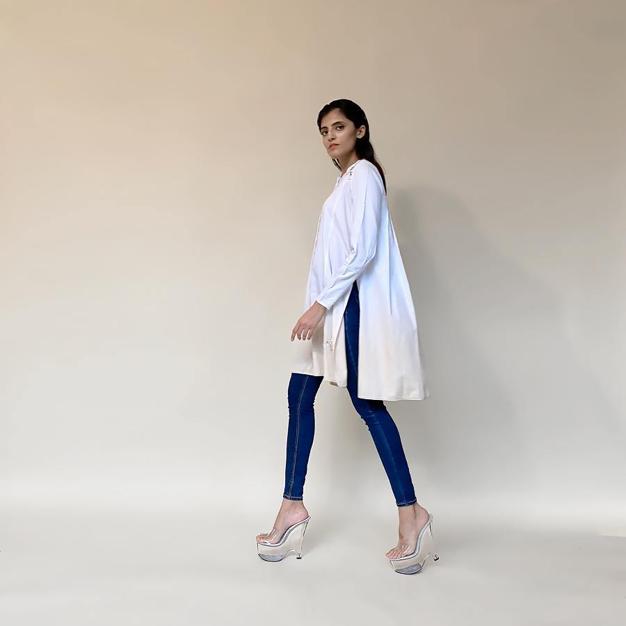 Multi panelled fine cotton shirt tunic. the tunic has ombre at the hem and is a easy fit style. the tunic can be paired with denim or fitted pants depending on you mood for the day. Its a perfect pick when you want to be easy yet elegant with the look. abhishekstudio, abhishek sharma