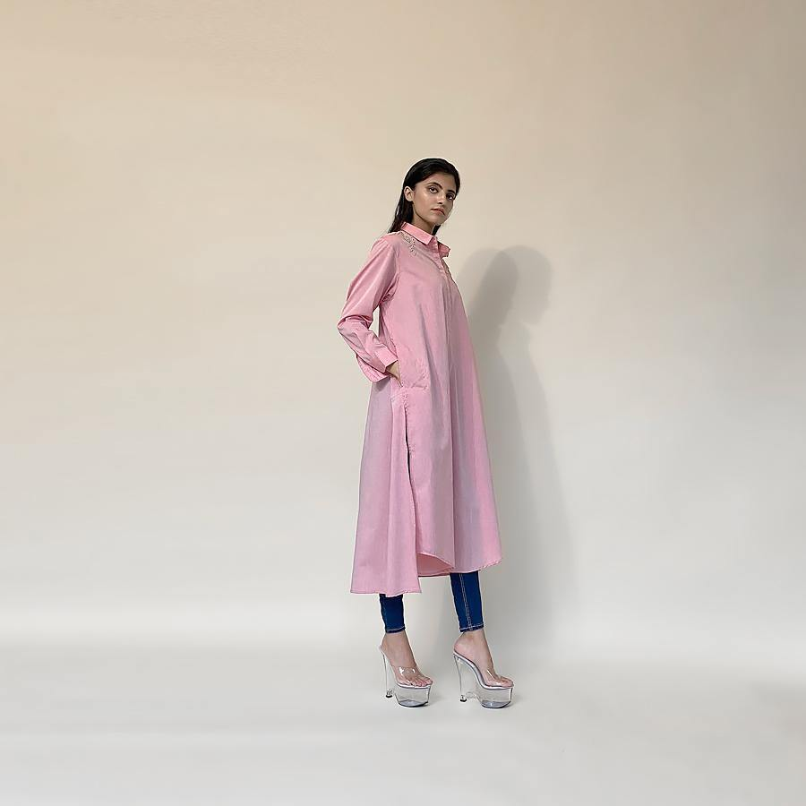 Fine cotton long tunic is an easy fit style. The tunic has fine Resham placement embroidery around the shoulder. The tunic can be paired with denim or fitted pants depending on your mood for the day. It's a perfect pick when you want to be easy yet elegant with the look. abhishekstudio, Abhishek Sharma
