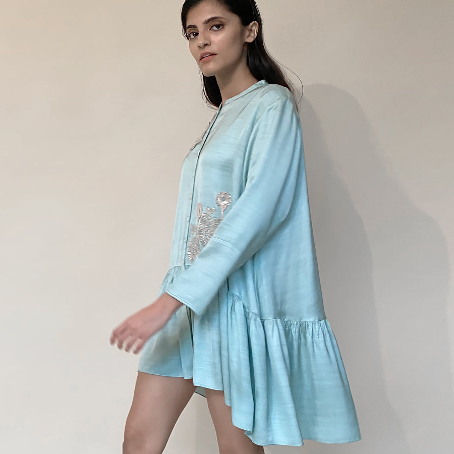 Satin gathered shirt with a narrow mandarin collar and 3D placement embroidery. The shirt enables a relaxed fit with buttoned front closure.  abhishek sharma, abhishekstudio