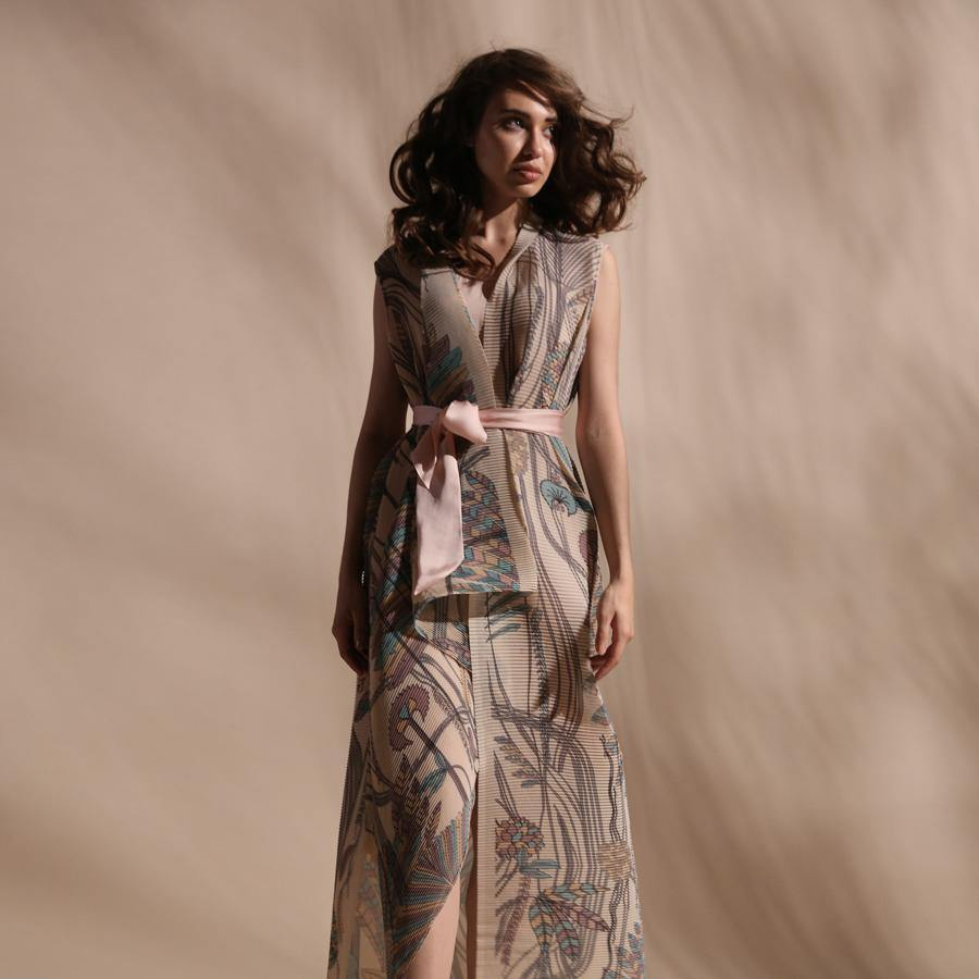 Forest print fine pleated texture layered draped jacket with satin tie up belt. The jacket has a front overlap and a separate crepe inner. The layered jacket has a raised neck. abhishek sharma, abhishekstudio