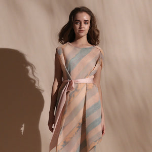 Stripe batik print fine pleated texture draped dress with satin tie up belt. Its a sleeveless look with a crepe inner. The dress is draped in bias and the print appears visually as an interesting mix of bias and vertical stripes. abhishek sharma, abhishekstudio