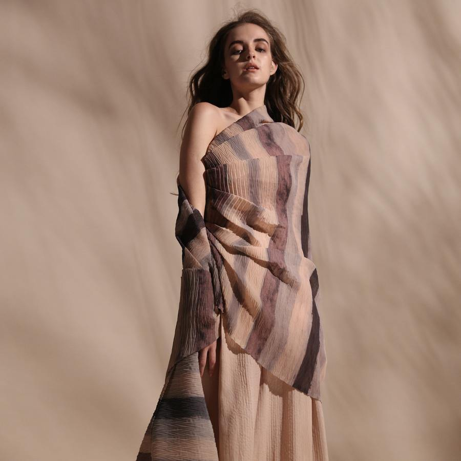 Batik stripe print fine pleated texture wrap top teamed up with high waisted chiffon textured wide pants. One off shoulder draped top has an elegant yet young vibe.abhishek sharma, abhishekstudio