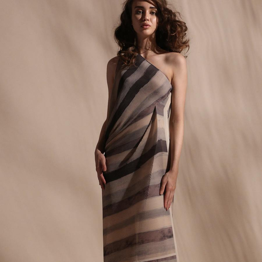 Stripe batik print fine pleated texture draped dress. Its one off shoulder dress with a attached stretch inner. Crafted in fluid fabrics, Abhishek Sharma's modern statement pieces pack in innovative drapery. abhishek sharma, abhishekstudio