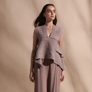 Cotton dobby self textured draped top teamed up with high waisted textured wide pants. The look is perfect for high tea, lunch or even a day affair. Feel fresh and comfortable with this look.  abhishek sharma, abhishekstudio