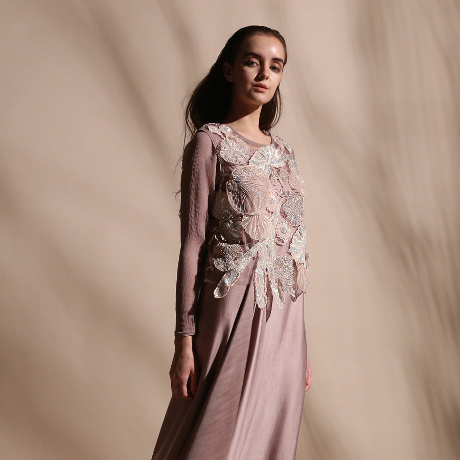 Shear net crop top tailored with chiffon sleeves and satin draped dress. Top is embellished with intricate sequin/pearl applique and bugle beads in forest motifs. abhishek sharma, abhishekstudio