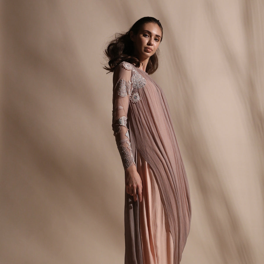 Gathered cowl draped kurta with embellished net sleeves.Dress is styled with a comfortable stretch net pants. Layered design combines fluid shapes with pearl and sequin placement embroidery. abhishek sharma, abhishekstudio