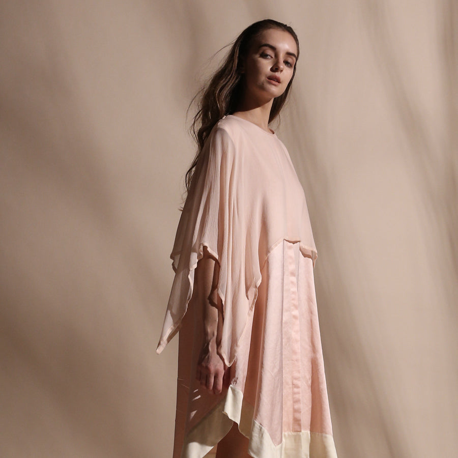 Satin tunic with contrast hem and layered chiffon cape. The cape compliments the knee length asymmetric hem for an elegant yet fluid look.  abhishek sharma, abhishekstudio